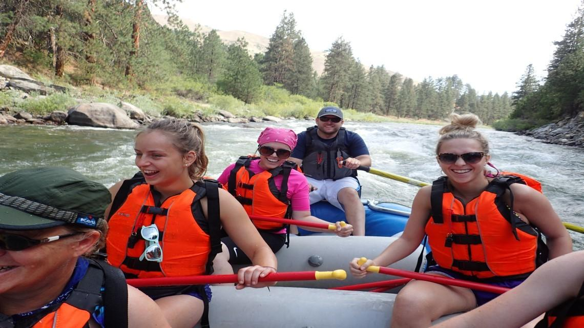 six students on a rafting trip