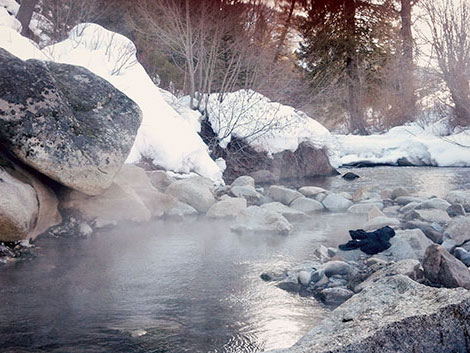 steaming, warm natural pools with snowy banks
